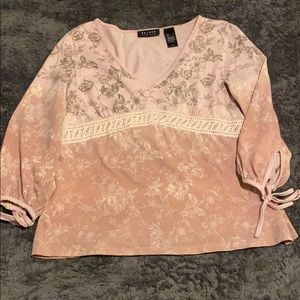 Pink blouse with ribbons on the sleeve
